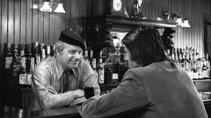 In happier times, Morris Martick chats with a patron at Martick's Restaurant Francaise. You had to ring at the locked front door to be let in.