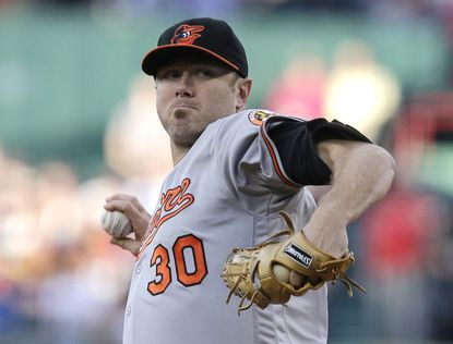 Baltimore Orioles starting pitcher Chris Tillman delivers during the first inning of a baseball game at Fenway Park, Tuesday, June 14, 2016, in Boston.
