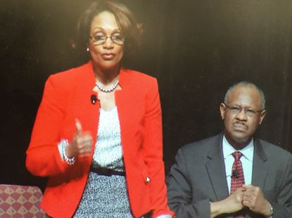 Mayoral candidates Sheila Dixon and Carl Stokes speak at a debate.