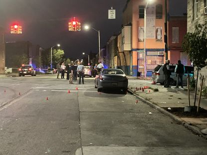 Baltimore Police investigate a shooting that occurred around 6:45 p.m. Wednesday at North Patterson Park Avenue and East Preston Street, near the southeast corner of Collington Square Park.