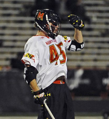 Maryland's Bryan Cole pumps his fist after scoring the winning goal in the fourth quarter against Loyola Maryland on April 8.