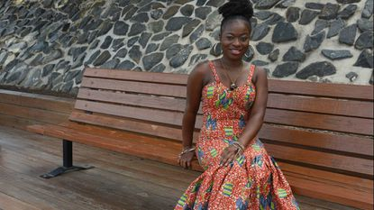 Columbia-based fashion designer Sandra Takyi, owner of Ohemaah Couture, models a gown she designed.