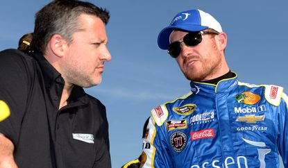 NASCAR driver Brian Vickers, right, speaks with car owner Tony Stewart afterqualifying Friday at Auto Club Speedway.