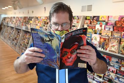 Scott Braden, co-creator of the comic book Kent Menace, at Gotham Comics in Westminster on Wednesday, Feb. 17, 2021.