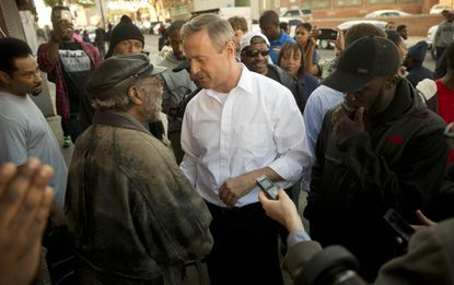 Former Maryland Gov. Martin O'Malley, center, meets with Baltimore residents on the day after riots broke out in the city on April 27.