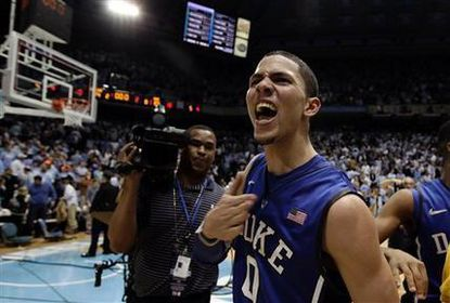 Duke Freshman Austin Rivers walks off the court in triumph after his buzzer-beating three-point basket and 29-point performance sent No. 5 North Carolina to a heart-breaking loss in a game that truly honored one of college basketball's great rivalries.