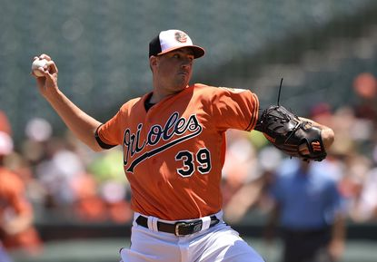 Baltimore Orioles starting pitcher Kevin Gausman delivers a pitch during the first inning of the first baseball game in a split doubleheader against the Tampa Bay Rays, Saturday, June 25, 2016, in Baltimore.