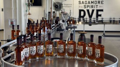 Bottles of Rye American Whiskey move along the bottling line at Sagamore Distillery in Port Covington. Barbara Haddock Taylor