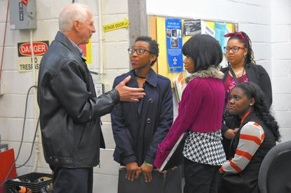"""Aen Bloom, grandfather of Svea Johnson (who plays Brigitta), talks with students (from left) Kenyetta Riddick, 15, Janel Stamper, 16, Diamon Harrison, 15 (sitting) and Demaris Fisher, 15, back stage, during the stage production of """"The Sound of Music,"""" at the Hippodrome Theatre."""
