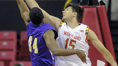 Terps center Michal Cekovsky, right, battles for a rebound with San Francisco State center Malik Edwards during an exhibition game early this month at Xfinity Center.