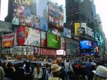 At any time of day, Times Square is likely to be filled with people.