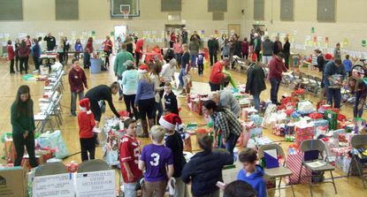 St. Margaret Church parishioners of all ages prepare food, gifts and other items for the approximately 340 families in Harford County that the Bel Air church is helping this season through its annual Christmas Giving Program.