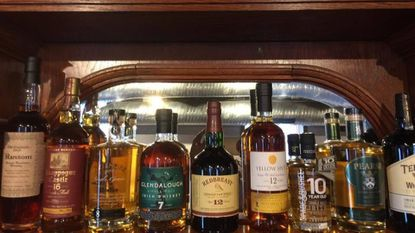 An assortment of Irish whiskeys behind the bar at the Back Yard, a new bar in Hollins Market.