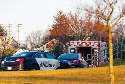 Carroll County Sheriff's Office cars and a Manchester ambulance sit in front of Manchester Valley High School on Wednesday morning after a school bus collided with another vehicle.