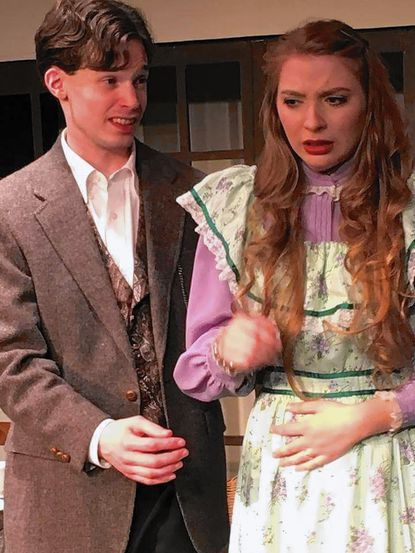 """Kyle Kelley and Julie Rogers, both of Laurel, playing Algernon and Cecily in """"The Important of Being Earnest"""" at Laurel Mill Playhouse."""
