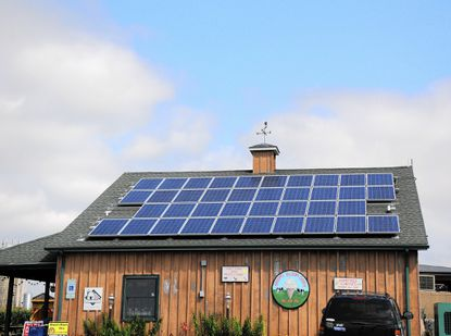 The owners Broom's Bloom Dairy near Bel Air installed 180 panels on the barn and 68 above the ice-cream store three summers ago in hopes of lowering their electric bill.