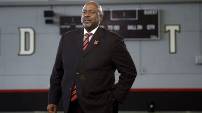New Maryland football coach Mike Locksley prepares to pose for a photograph after his introductory news conference Dec. 6, 2018, in College Park.