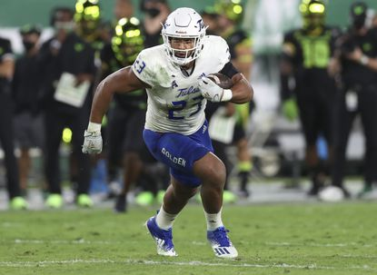 Tulsa linebacker Zaven Collins (23) runs for a touchdown after an interception against South Florida on Oct. 23. Navy will face Collins, an All-American candidate and semifinalist for the Butkus Award, and a vastly improved Golden Hurricane team Saturday at 3:30 p.m.