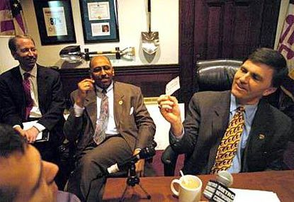 """Gov. Robert L. Ehrlich Jr. reads """"Never think you've seen the last of anything"""" on slots. Budget chief James C. """"Chip"""" DePaula at left, Lt. Gov. Michael S. Steele, center."""