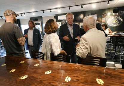 Maryland Comptroller Peter Franchot, center, talks to Westminster City Councilwoman Ann Thomas Gilbert and Carroll County Commissioner Richard Weaver, right, during a visit to Pub Dog Brewing's newly renovated tap room in Westminster Monday, July 22, 2019.