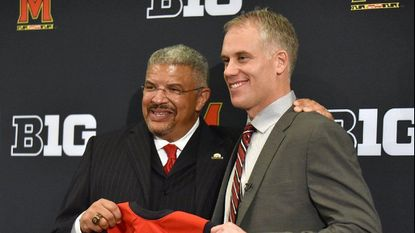 Kevin Anderson, left, with DJ Durkin after Durkin was introduced as Maryland's football coach in December 2015.