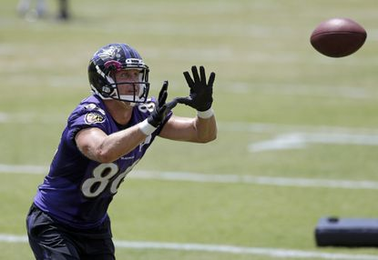 Baltimore Ravens tight end Konrad Reuland reaches for a pass during NFL football training camp, Tuesday, Aug. 11, 2015, in Owings Mills, Md.