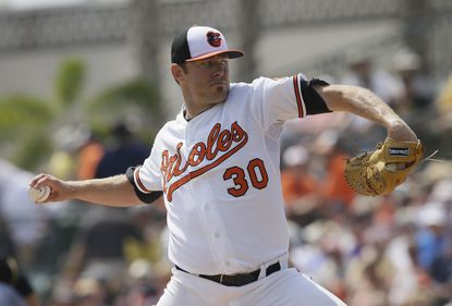 Baltimore Orioles starting pitcher Chris Tillman throws during the second inning of a spring training exhibition baseball game against the Pittsburgh Pirates in Sarasota, Fla., March 19, 2015.
