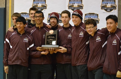 The Howard Community College men's cross country team poses with the third-place trophy at Finger Lakes Community College in Hopewell, N.Y., on Nov. 8.