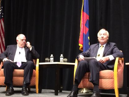 Republican Gov. Larry Hogan listens as Democratic Comptroller Peter Franchot describes their bipartisan friendship and partnership. They appeared together Friday during a panel discussion sponsored by the Greater Bethesda Chamber of Commerce and Bethesda Magazine.
