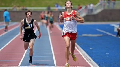 Dulaney senior Drew Dailey, right, wins the 1600-meter run by under a second over Richard Montgomery's Garrett Suhr in the Class 4A state meet. Dailey also won the 800 meters for the second-place Lions.