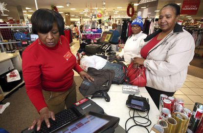 <p>J.C. Penney worker Wanda Cofield, left, assists Cynthia Putney, right, and Linda Pierce on Dec. 26 in Rocky Mount, N.C. Holiday sales rose to $691.9 billion in November and December, a 5.5 percent increase from the prior year, according to the National Retail Federation. </p>