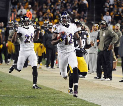Jacoby Jones takes a kickoff 108 yards for a touchdown in the fourth quarter Sunday night.