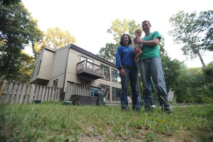 Ryan Gardner, Kristine Amari and their daughter Alice Amari at their home in Columbia, where they recently had a geothermal heating and cooling system installed.