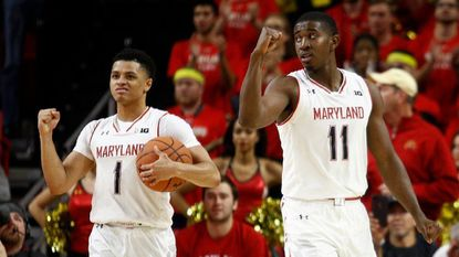 Maryland guards Anthony Cowan Jr. (1) and Darryl Morsell celebrate in the final moments of an NCAA college basketball game against Penn State, Saturday, Dec. 1, 2018, in College Park. Maryland won 66-59.