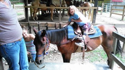 Alyssa Rhine, 10, shown riding a horse in North Carolina on Sunday, July 10, has multiple bone deformities in her legs and is a beneficiary of the Mitchell Ride for Children fundraiser.