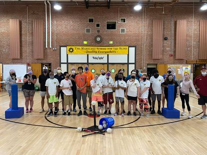 Participants at Camp Abilities at the Maryland School for the Blind pose with representatives from League of Dreams during a week of athletics and activities.