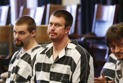 In this May 8, 2012, file photo, Ryan Leaf, center, sits in a Cascade County courtroom in Great Falls, Mont.