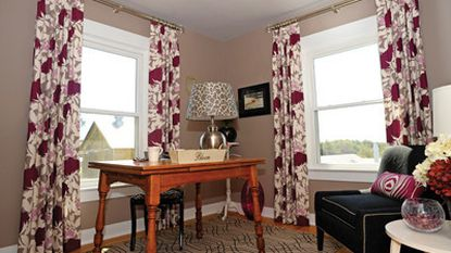The grayish/brown paint (Benjamin Moore Creekbed) designer April Force Pardoe used in this home office for the 2010 Historic Ellicott City decorator's show house was pulled directly from the bold Thomas Paul drapery fabric.