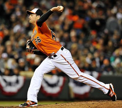 Baltimore Orioles pitcher T.J. McFarland, making his major league debut, delivers against the Minnesota Twins in the fourth inning of a baseball game Saturday, April 6, 2013 in Baltimore. (AP Photo/Gail Burton)