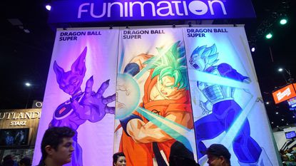 Attendees walk in front of the Funimation booth at this year's Comic-Con International in San Diego.