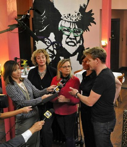 """At a press conference held for the benefit of """"Kitchen Nightmares,"""" the TV show hosted by Gordon Ramsay, center, Cafe Hon owner Denise Whiting, third from left, (in eyeglasses) announced that she is relinquishing the """"Hon"""" trademark. Standing next to Whiting are Cafe Hon manager Deborah Harris, second from left, and Lisa Davis, Honfest planner, behind Ramsay."""