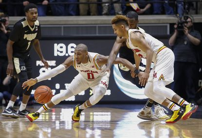 Rasheed Sulaimon reaches for a loose ball as Melo Trimble of the Maryland Terrapins looks on against the Purdue Boilermakers at Mackey Arena on February 27, 2016 in West Lafayette, Indiana.