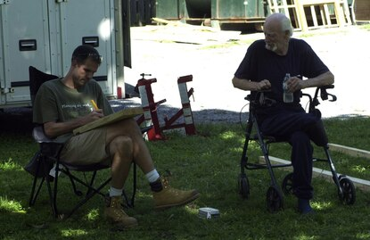 Executive Director of the Carroll County Habitat for Humanity Bryan Lyburn (left) sits with Jerry Gibson in Finksburg during a repair project on Gibson's home in 2013.