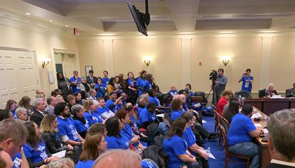 """Education advocates wearing shirts with the slogan """"Our kids can't wait"""" pack a public hearing of the Kirwan Commission in Annapolis on Tuesday, Nov. 12, 2019."""