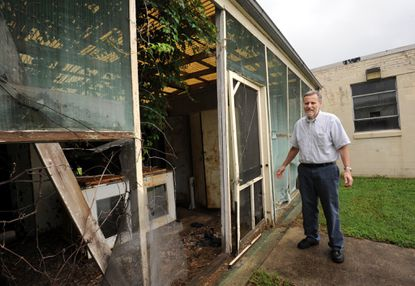 Joseph T. Spence, director of the USDA's Agricultural Research Service, tours building 048, one of many federally owned buildings that have been deemed as surplus on the grounds of the USDA.
