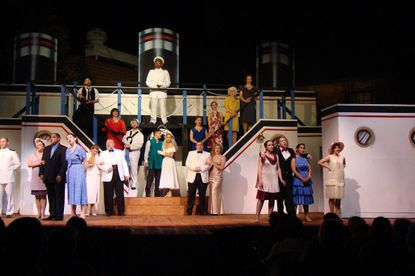 """Performer's in AGST's production of """"Anything Goes"""" include Wendell Holland (Captain), center; Alex Trujillo (Billy Crocker), below center with Katie Gardner (Hope Harcourt); and Jeff Sprague (Lord Evelyn Oakley), lower deck center with Nicole Anderson (Reno Sweeney)."""