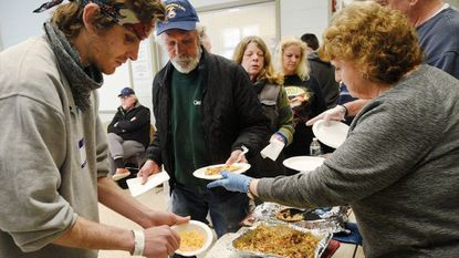 Volunteers Cindy and Frank Potee, right, serve a hot lunch to, from left, Robert Gilkerson, Al Jackson, Betty Bargar and DeeAnn Taylor at the Carroll County Cold Weather Shelter in Westminster Wednesday, Feb 20, 2019.