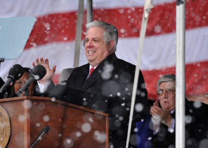 Larry Hogan was sworn in publicly as governor Wednesday amid heavy snow flurries.
