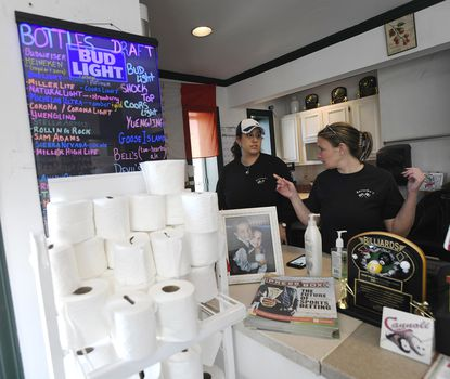 Owner Anna Di Fatta Cannon and Tammy Wilhelm go over orders at Belisimos in Finksburg Thursday, March. 26, 2020. Belisimos is stocking everthing from toilet paper and cleaning supplies to alcohol and bulk meat for pick up or local delivery.