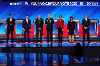 Democratic presidential candidates take the stage at the start of the primary debate in the Sullivan Arena at St. Anselm College in Manchester, N.H. on Feb. 7, 2020.